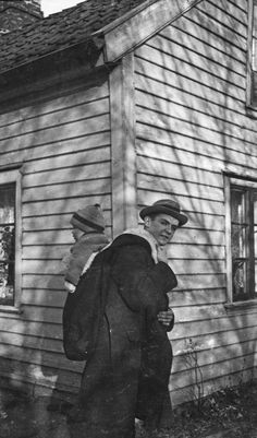 Man carrying in unknown carrier. Norway ca. 1915-1925.