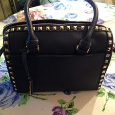 "STUDDED NAVY SATCHEL PRICE FIRM! NO BUNDLE!!!  Haute Q Kensie collection handbag which features studs all along one side & surrounding top zipper. One outside snap pocket & one inside zipper compartment in deep navy blue. Width 12"" & height 10"" & shoulder strap 33"" Poly lining, poly/man made exterior. CAN NOT BE INCLUDED IN BUNDLE!!!  Bags Satchels"