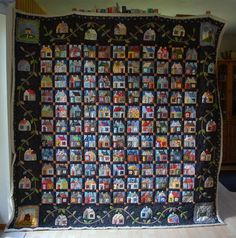 susis quilts:   a great scrappy house quilt.  On my bucket list.