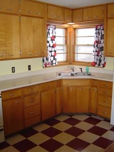 check out the crazy-patterned linoleum floor in this 1940s kitchen