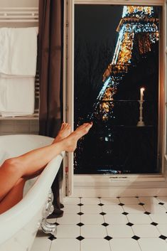 Taking a bath in front of the Eiffel Tower! Find the apartment at the link ;)