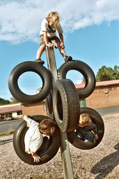boys and tires, pioneer playground. Looks like some kind of metal post…needs a topper of some sort I think.
