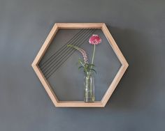 "Hexagon Solid Oak Shelf - Application of threads to create a unique decorative effect. Thread color of your choice: black / pink. Hidden hanging mechanism. Dimensions: 9.8"" x 6 faces (25cm x 6 faces) Total shelf (height/width): 17.7"" x 18.1"" (45 x 46 cm)"