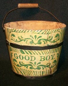 Good Boy Painted Bucket American., Late 19th century. A very nice childs bucket in the original yellow paint with green stencil decoration. Original handle and orginal bands. Nice and tight. Excellent condition with strong paint. Minor scratches here and there from use but pretty mint and dry.   Measuring 4.5'' tall to bucket, about 7'' tall when handle is up. Almost 6'' in dia.