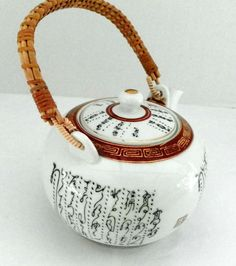 Ceramic White Teapot w/Lettering & Scrollwork Rattan Handle holds 4 cups    M7