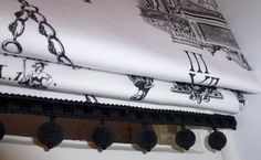 Hand made roman blind in Timney Fowler's Clocks fabric with black pompom trimming by Catherine Lepreux Interiors Edinburgh Fife & Perth
