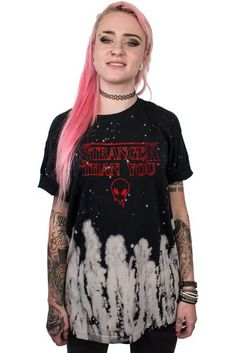 """This super soft, over sized Tie-Dyetee has an extra soft print on the front that reads STRANGER THAN YOU with a tiny alien dude on the front. Female model is 5'5"""" and wearing a size Small.  100% Cotton Made in the USA  Machine wash only. Do not tumble dry. View inside label for specific care instructions."""