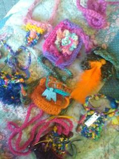 crocheted amulet bag necklaces
