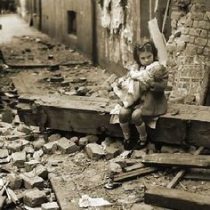 Liverpool Blitz Girl- A girl surrounded by bomb damage