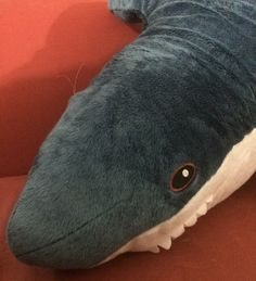 Poor Eugenie the shark came from the Ikea scratch-and-dent sale area.  She need a patch from where she was hung in a display using fishing line....