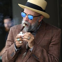 You may be cool. But you'll never be  cigar-chomping, gray pigtailed beard, panama hat wearing dude in blue shades cool.