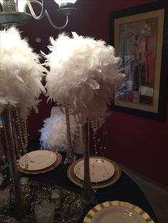 "Feather boa 'bouquets' for table centerpieces on 24"" clear vases filled with gold spray painted beans"