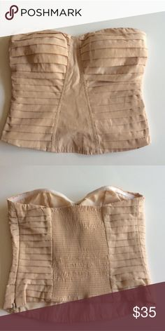 UO Pink Bustier Style Crop Top Blush champagne color. Side zipper. Reposh item, doesn't fit me correctly. Crop top bustier style. Great condition. Pleated front. Elastic portion in back. From Urban Outfitters. Strapless. Urban Outfitters Tops