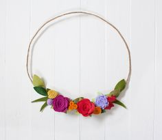 The perfect simple felt flower wreath for your wall or front door!  Material: Paper Wire Wreath Form, Wool Blend Felt Size: 11 tall and wide