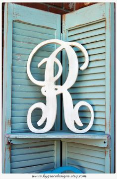 One color Handpainted distressed 24inch wood letter in monogram font Or font of your choosing I can cut any font from fontyukle. $25.00, via Etsy.