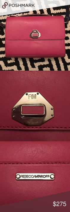 Rare Rebecca Minkoff Bag This is an authentic Rebecca Minkoff bag that is a sample. I truly think the bag is one-of-a-kind as I cannot find a bag online that looks anything like it. It has her official name logo branding on the back and an RM monogram on the turnlock closure. The inside is unlined w/no branding. Bag is made from leather. Navy blue studded handle and matching adjustable shoulder strap. Shows minor wear. 💥💥💥Accepting offers! 💥💥💥 Rebecca Minkoff Bags