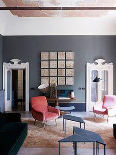 Rugs 101: Your Ultimate Guide to Rug Shopping // Green velvet sofa, orange velvet chair, triangle coffee tables