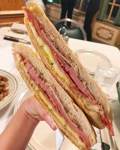 Finally after all my trips to Miami I had the infamous @versaillesmiami cubano and lemme say it totally delivered. The cheese was on point and it was massive! Cheat tip - we got a side of the garlic sauce for dipping perfection. #Miami #LittleHavana #Cubano #Sandwich