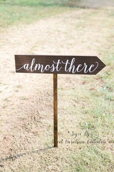 Almost There Wooden Wedding Sign - WS-219 by Sweet Carolina Collective  DETAILS: This listing is for one almost there wooden wedding sign on one 3 ft stake. This sign is a great way to direct guests to your wedding ceremony. The sign pictured is stained in an dark walnut and hand painted in white acrylic. Paint/stain colors can be changed to match your wedding reception and/or special event.  AS SEEN IN STYLE ME PRETTY…