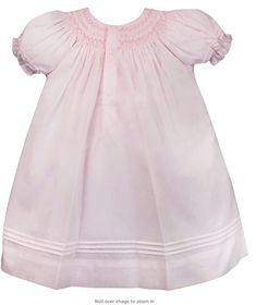Cute smocked baby dress made on lightweight batiste fabric that keeps baby comfortable and cool. Heirloom-quality construction features heart smocking and embroidered flowers. Button closures at the back of the neck of this fashionable baby clothes for easy on and off. #babygirl #kid #babyoutfit Family Photo Outfits, Family Photos, Smocked Baby Dresses, Spring Dresses, Embroidered Flowers, Dress Making, Smocking, Beautiful Outfits, Cold Shoulder Dress