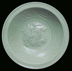 A Celadon porcelain plate with dragon, China, Ming Dynasty, 15th century