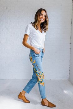 DETAILS: With beautiful and colorful embroidery down the sides, these high-rise jeans are in a girlfriend fit. Authentic, comfort stretch...
