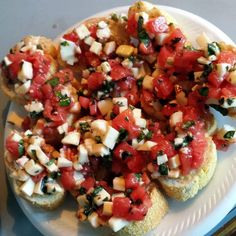 Bruschetta with Tomato. Basil. and Mozzarella! 1 pound · Ripe plum tomatoes. peeled and seeded 2 medium · Garlic cloves. minced 3 tablespoon · Finely chopped fresh basil 1 tablespoon · Finely chopped Italian parsley 2 tablespoon · Extra virgin olive oil ? teaspoon · Salt ? teaspoon · Coarse black pepper ? pound · Fresh Mozzarella. cut into 1/2 cubes