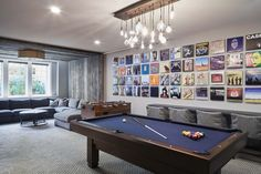 Morgante Wilson designed a  pool table area that included our clients record album covers mounted above a custom zinc-wrapped drink ledge and Lee Industries slip-covered counter stools. The media area was designed around an upside-down U-shape barn wood panels. The barn wood panel shown partially covering the album covers was designed to hide and allow access to the electrical panels located on the wall behind.