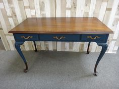 A complete redo on this vintage desk picked up at a thrift store. The frame was painted in elegant teal blue and punctuated by new hardware our client found on Etsy (agreat resource for vintage hardware).