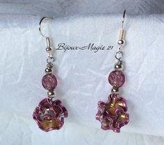 Boucles d'oreilles courtes et légères,perles et cerclage capsules tisanière http://www.alittlemarket.com/boutique/magie_encapsulee-803147.html