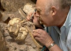 """Professor Ron Clarke working on the between 4.1-million and 3.3-million years old """"Little Foot"""" skeleton found at Sterkfontein in the Cradle of Humankind, South Africa."""