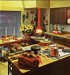 70's tacky chic. I love the island stove top and the corner wood burning stove. I would update that to a bread/pizza oven