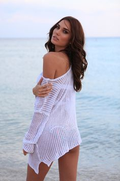 Fun and flirty this Crochet Bikini Cover Up is perfect for a simple beach day, or even stopping by a popping pool party in Miami beach. Its Super soft material is comfortable and breathable and gives you that allure that mixes designer NYC chic with beach gypsy mermaid. Simply slip it over your bikini to transform your look. #bikinicoverup #coverup #coverupdess