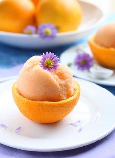 INSPIRATION - Grapefruit sorbet presented in grapefruit half + flower (no recipe)