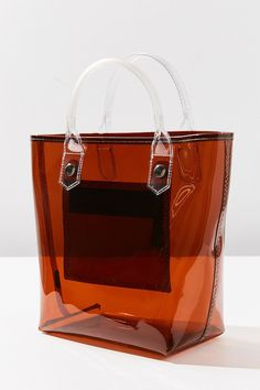 72a196cb8910 See-Through Bags Have Taken Over The Streets+ refinery29 Clear Bags