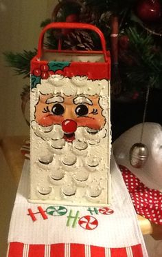 I painted an old cheese grader & turned it into a Santa.  I set a Tea Light candle inside to put off a nice glow.