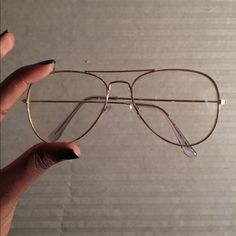 Gold Clear Aviator Glasses worn once. has a small crack on left lense but not noticeable when worn. only visible up close. Accessories Glasses