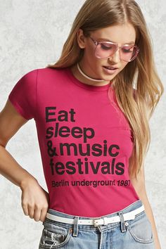 "A knit tee featuring a round neck, short sleeves, and graphic text ""Eat Sleep & Music Festivals Berlin Underground 1987"" on the front."