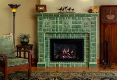 Ginkgo Fireplace by Motawi Tileworks - Arts and Crafts fireplace by Motawi Tileworks featuring Ginkgo and Medieval Cat relief tile in Lich - Fireplace Art, Living Room With Fireplace, Fireplaces, Easy Arts And Crafts, Design Department, Farmhouse Christmas Decor, House And Home Magazine, Tile Design, Beautiful Interiors