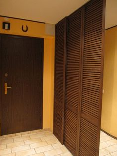 sliding panel doors - to cover the TV? Sliding Panels, Panel Doors, Windows And Doors, Sliding Doors, Man Room, Doorway, Home Projects, Home Office, Tall Cabinet Storage