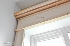 Window header in place / Make a farmhouse window - add window trim to beef up a plain window with no miter cuts in sight! via http://www.funkyjunkinteriors.net/