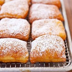 Beignets (Zeppoli Doughnuts) Serve warm with chocolate to dip them in.
