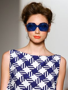 Karen Walker. blue sunglasses.