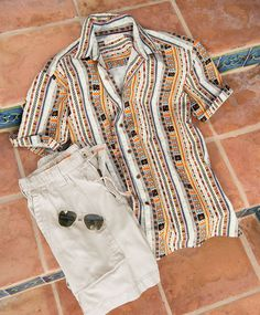 Cool outfits are a must for summer. Comfortable drawstring shorts + colorful patterned button front t-shirt + stylish sunglasses = perfect outfit for guys