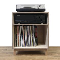 The Turntable Console houses your turntable, amplifier and 100 records in style. Made from sustainable birch plywood with an intense black finish on the top and sides. Sits on solid oak legs. The plywood back panel includes a cut out for cables. Dimensions: h630 x w 510 x