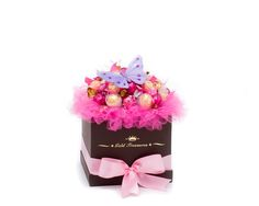 This Shocking Pink basket makes a gorgeous gift that no one can resist! Complete with 13 Ferrero Rocher Chocolates, 8 Godiva Milk Chocolate Truffles and 14 Lindt Raspberry Lindor Truffles , this stunning arrangement makes a gift that's impossible to resist.