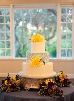Elegant yellow and robin egg blue wedding cake | Photo: Justin DeMutiis Photography