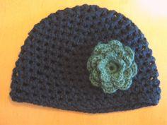 Wow, this has been a project.         First, my daughter (#4) has this black crocheted hatwith agreen crocheted flower on it (it wa...