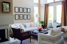 While Louise isn't one to shy away from bold colors and prints inher wardrobe, her home needed to be a comfy and calming counterpoint. Cue the furnishings increams, dark woods, and rich leathers, whichinclude white club chairs and a sofa found on One Kings Lane.