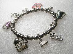 Silvertone Stretchy Cheerleader Charm Bracelet - 12 charms - silvertone beads #Unbranded
